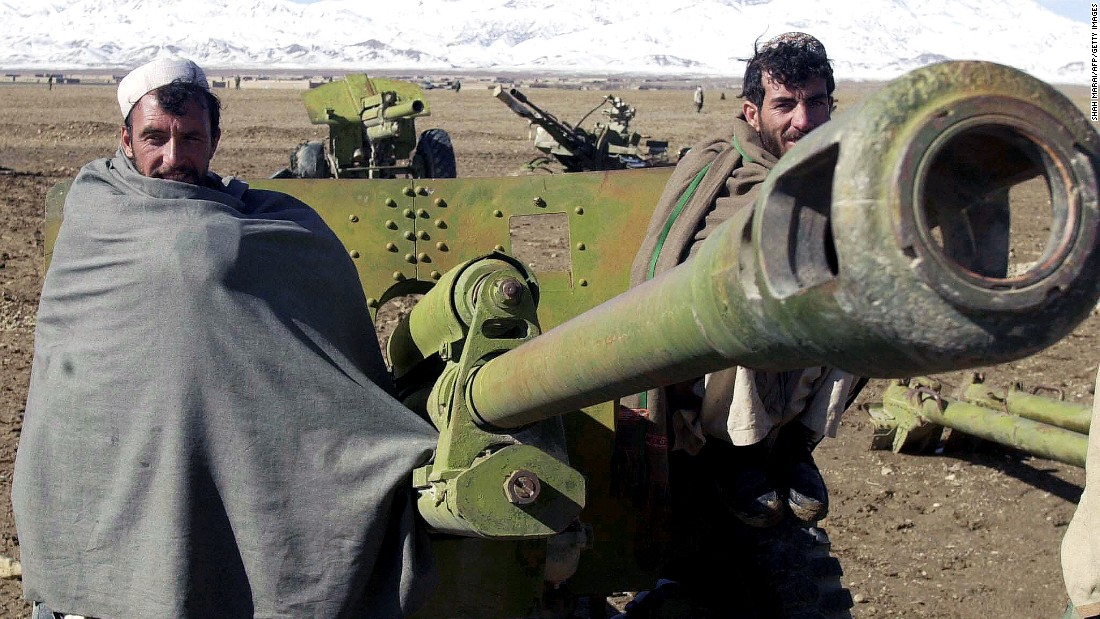 Afghan militiamen pose in front of a 80mm rocket launcher during a disarmament cermony in Gardez, the capital of Paktia province, November 2003.