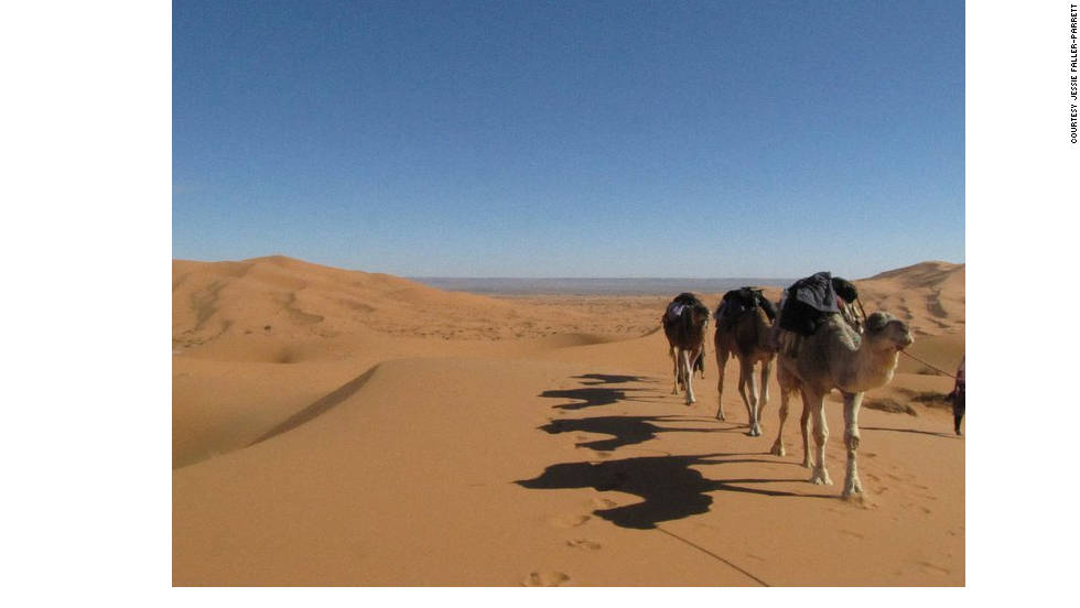 """Jessie Faller-Parrett """"took a two-day, two-night camel trek into the desert and rode camels, spent the nights in camps with Berber families, ate wonderful meals, hiked sand dunes, and saw an endless sky of stars."""""""