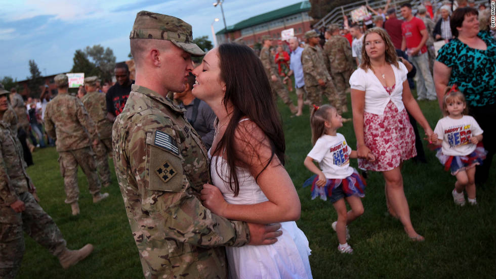 Nicole Merkt greets her husband, Spc. Jake Merkt, from his return from Afghanistan during a welcome home celebration in Carson, Colorado, on July 9, 2011. In June, President Obama announced that all of the 33,000 additional U.S. forces deployed to Afghanistan in December 2009 will return home within 15 months. He also announced that U.S. combat operations in Afghanistan would end by 2014.