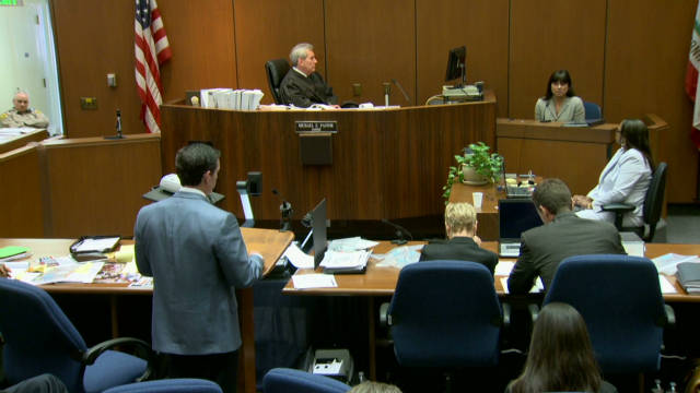 Defense confronts Coroner about testimony