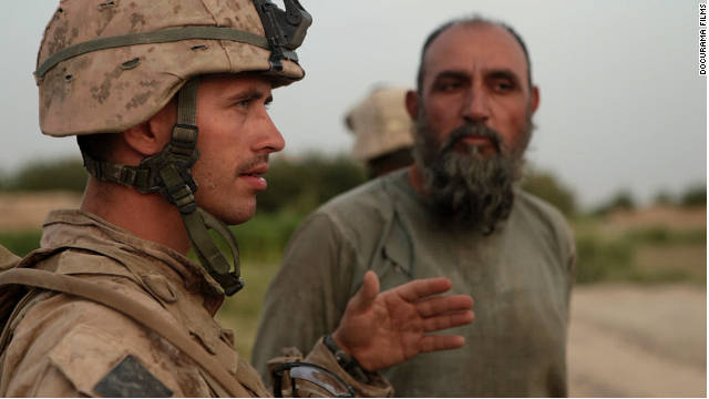 "Marine Sgt. Nathan Harris talks to a man in Afghanistan in the film ""Hell and Back Again."""