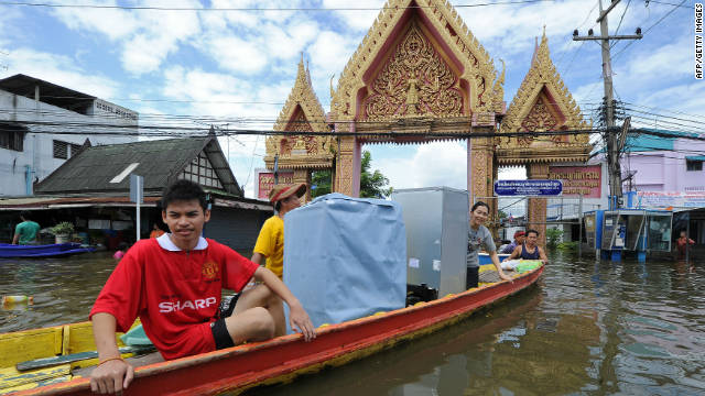 Thai residents transport their belongings on a boat along a flooded street in the city of Ayutthaya on October 6.