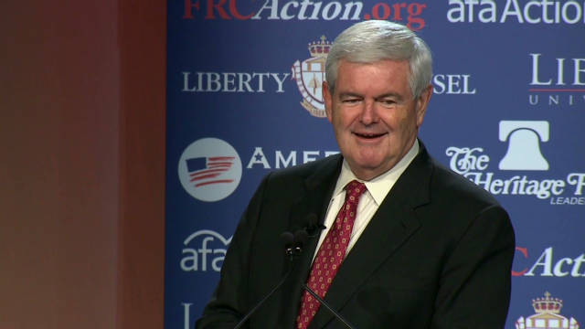 Gingrich jabs Perry, Romney