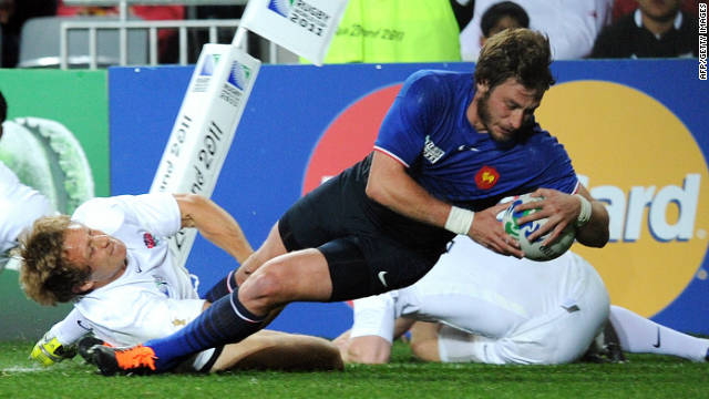 France fullback Maxime Medard scores a first-half try against England at Auckland's Eden Park.