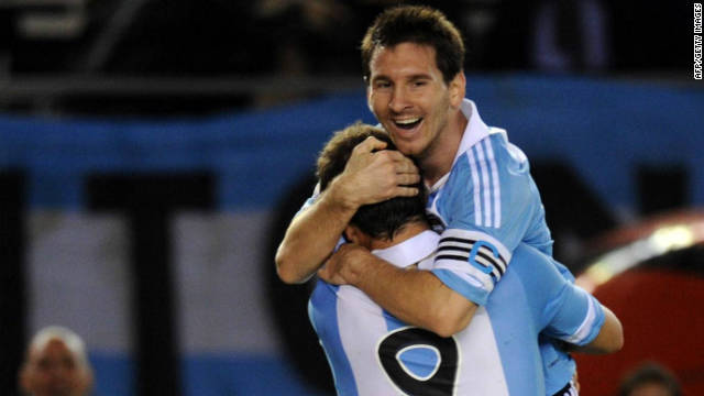 Argentina's Gonzalo Higuain (front) and teammate Lionel Messi celebrate after the home team's fourth goal against Chile.