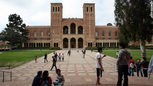 Students sit on campus at UCLA. A new California law will allow immigrants to receive state funds.