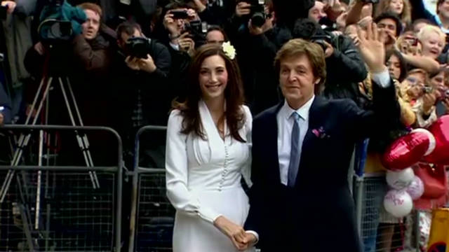 Paul McCartney walks down the aisle