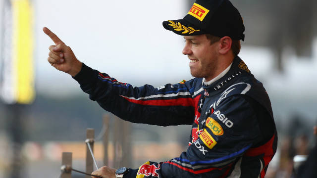 Sebastian Vettel stands on the Suzuka podium after making Formula One history.