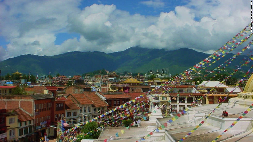 "Eleanor MacAllister of Edmonton, Canada, visited Nepal in 1985 and shared photos from her trip. She ate lunch in a building overlooking the Boudhanath temple and took this picture of the city view from there. Kathmandu was MacAllister's starting point for a long trip through Tibet and back. She said she never thought she'd ever visit Kathmandu or Tibet, but found herself there anyway and tried to soak in the exotic experience. She cautioned visitors that conditions could get dusty. ""I've been to other places in Asia and had thought that there would be more modern, Western-type buildings in Kathmandu. The roads were narrow and in poorer condition than I had expected."""