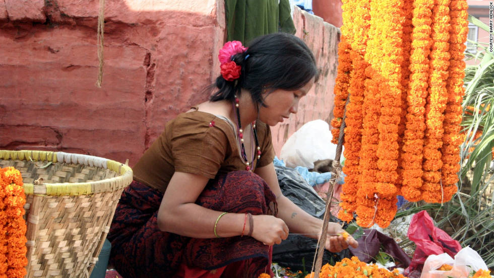 Barry Wenlock lives in Kathmandu and has led many treks through the Himalayas. He shared photos taken during the 15-day Dasain festival, the country's largest event. In this photo, a young woman is stringing marigold flowers in Durbar Square to get ready for the annual traditional event. The festival ran from September 28 to October 11 this year. Each day has a special name and theme. Wenlock noted that the seventh day of the festival, known as Fulpati, features celebrations of the military including marches and blessings of vehicles.