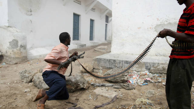 Hard-line islamist fighters exchange gun fire with government forces in Mogadishu on July 3, 2009.