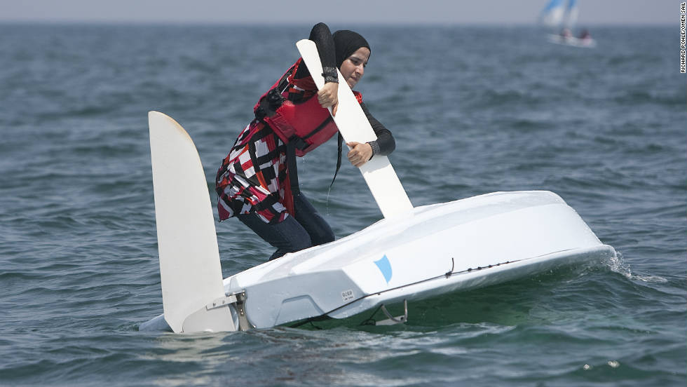 As her boat capsizes during training, a particpant of the programme tries to turn it around.