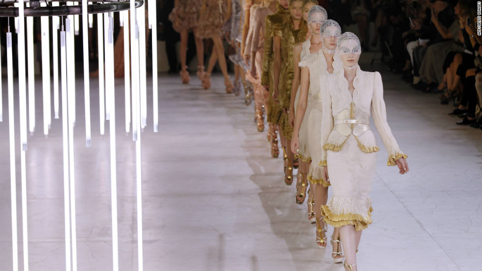 Models present creations by Sarah Burton for Alexander McQueen on October 4 in Paris. Experts predict next season will be about celebrating the female form.