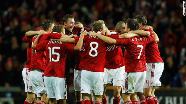 Denmark's players celebrate their 2-1 home win over Portugal to book their place in Euro 2012
