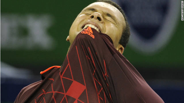 Jo-Wilfried Tsonga feels the pain after slumping out of the Shanghai Masters