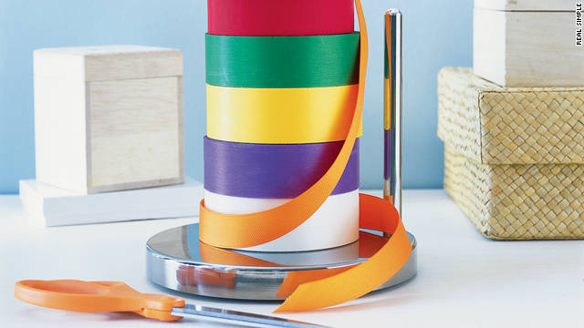 No more knots to untie when it comes time to dress a present with ribbon -- just use a paper towel holder.