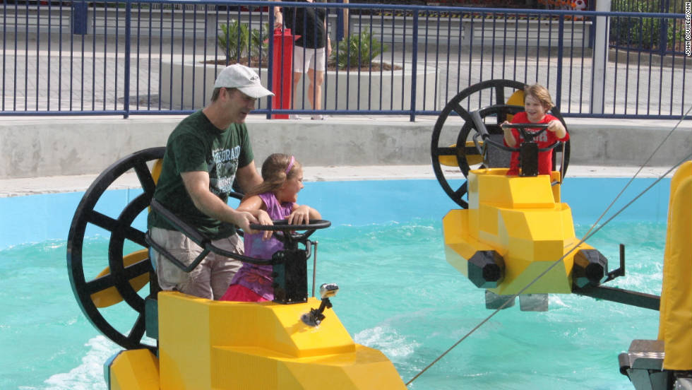 Park-goers try out a Legoland ride during a preview visit.