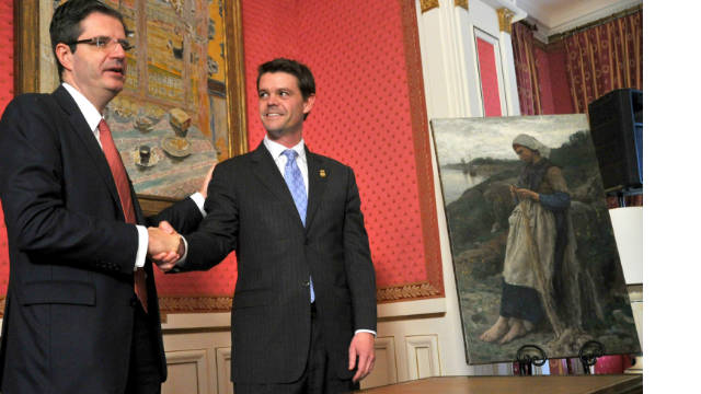 French Ambassador François Delattre, left, shakes hands with ICE Director John Morton during the ceremony Thursday.