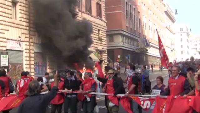 Rome protesters break windows, burn cars