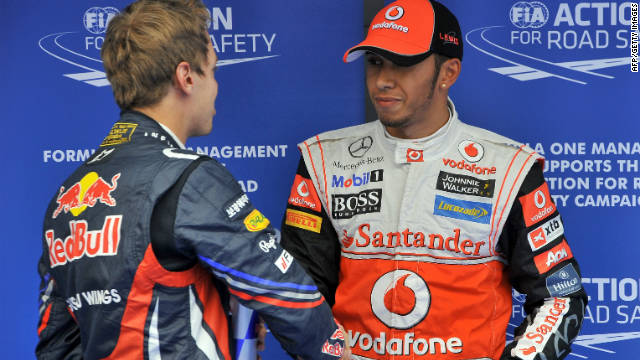 Lewis Hamilton is congratulated by Sebastian Vettel after claiming pole position in Korea.