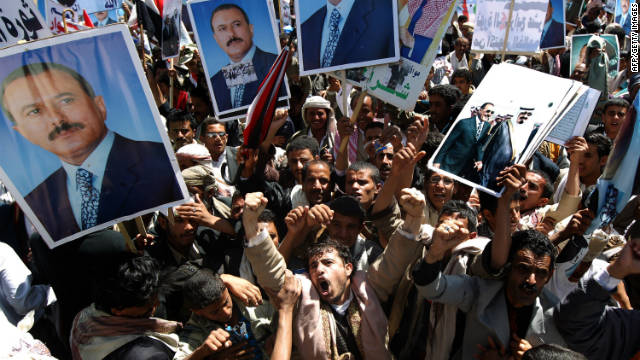 Supporters of  Ali Abdullah Saleh chant pro-regime slogans during a rally after the Friday noon prayers in Sanaa on October 14