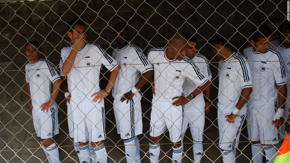 The Libya team wait nervously in the tunnel, waiting for the moment to walk out on to the pitch. There was some confusion over which of Libya's national anthems would be played. The Zambian government is yet to recognize the National Transitional Council.