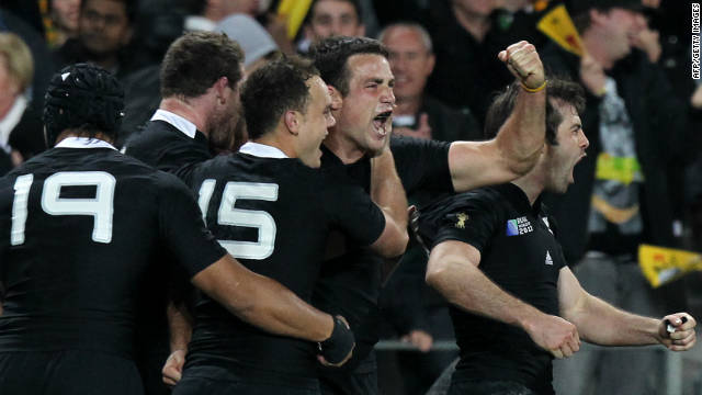 The New Zealand All Blacks celebrate their 20-6 semifinal win over Australia.