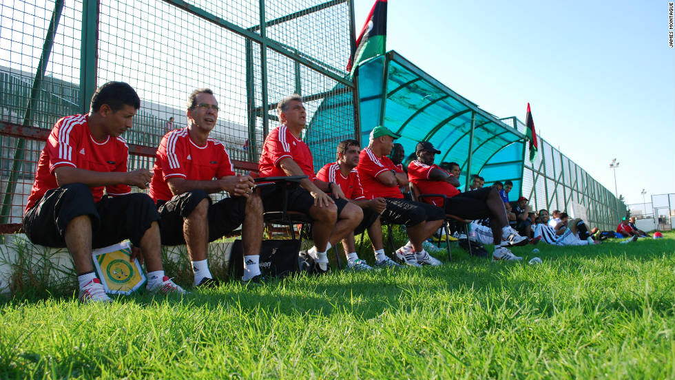 The coaching staff, including coach Marcos Paqueta, watch on as the team plays its final warm-up match against Avenir Sportif De La Marsa. Two of Libya's players are injured in the first half and cannot travel to Zambia, including goalkeeper Guma Mousa. He had come back from fighting on the front line unscathed. Libya won 3-2.