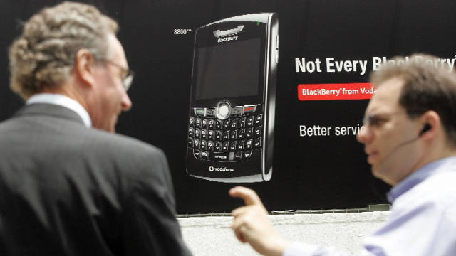 Pedestrians talk in front of a BlackBerry advertisement in Hong Kong in this 2007 photo.
