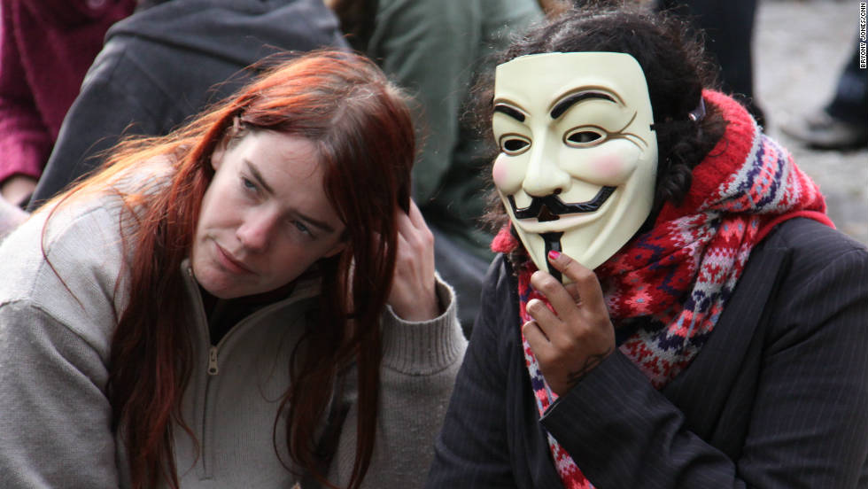"Another protester sports the mask, made famous by the film ""V for Vendetta,"" at the Occupy London demonstration at St Paul's Cathedral."