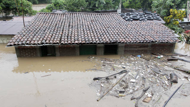 View of a flooded area in Ciudad Arce, 40 km west of San Salvador, El Salvador on October 16, 2011. According to Civil Protection authorities, 27