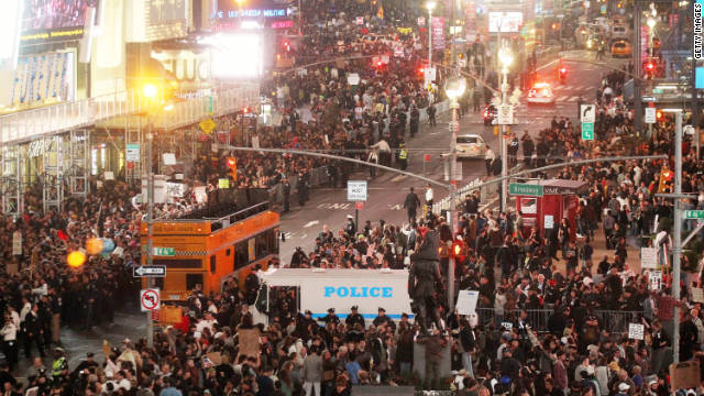 Occupy Wall Street participants stage a protest on Times Square in New York on October 15.
