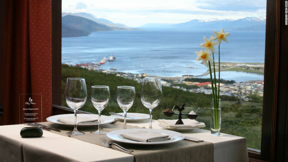 "Chez Manu, a French restaurant near Ushuaia, Argentina?the southern-most city in the world?pairs breathtaking views of Beagle Channel and a menu of local specialties with a French twist. (Think Fuegian rabbit in an aged mustard sauce.) See more photos on <a href=""http://www.budgettravel.com/slideshow/photos-12-restaurants-with-spectacular-views,7588/ "" target=""_blank"">BudgetTravel.com</a>."