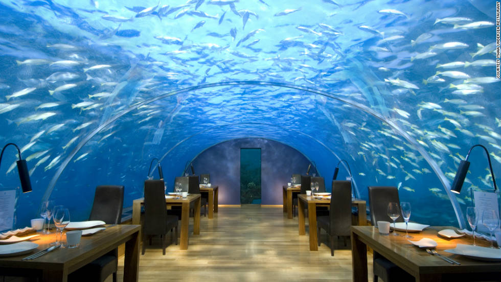 "There are only 12 seats at the Ithaa undersea restaurant off Rangali Island in the Maldives, and all of them have equally fantastic views of the Indian Ocean overhead. See more photos on <a href=""http://www.budgettravel.com/slideshow/photos-12-restaurants-with-spectacular-views,7588/ "" target=""_blank"">BudgetTravel.com</a>."