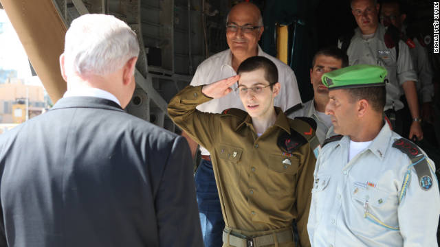 Gilad Shalit salutes Netanyahu on October 18, 2011.