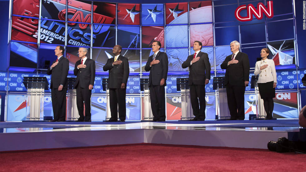 The GOP presidential candidates say the Pledge of Allegiance before the debate.