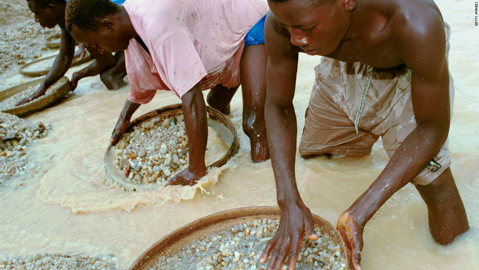 Workers pan for diamonds in a mine near Kenema, Sierra Leone, in June 2001. Diamonds were the main issue in the country's decade-long tumultuous civil war.