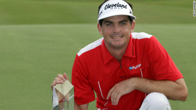Keegan Bradley proudly displays his winning trophy at the Grand Slam of Golf
