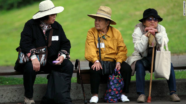 Senior citizens take a break on a bench during the 8th Annual Healthy Living Festival this summer in Oakland, California.