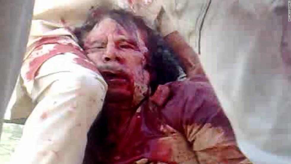 An image on a cellular phone camera purportedly shows the arrest of Libya's deposed leader Moammar Gadhafi in Sirte on Thursday, October 20. CNN cannot independently verify the authenticity of this still.