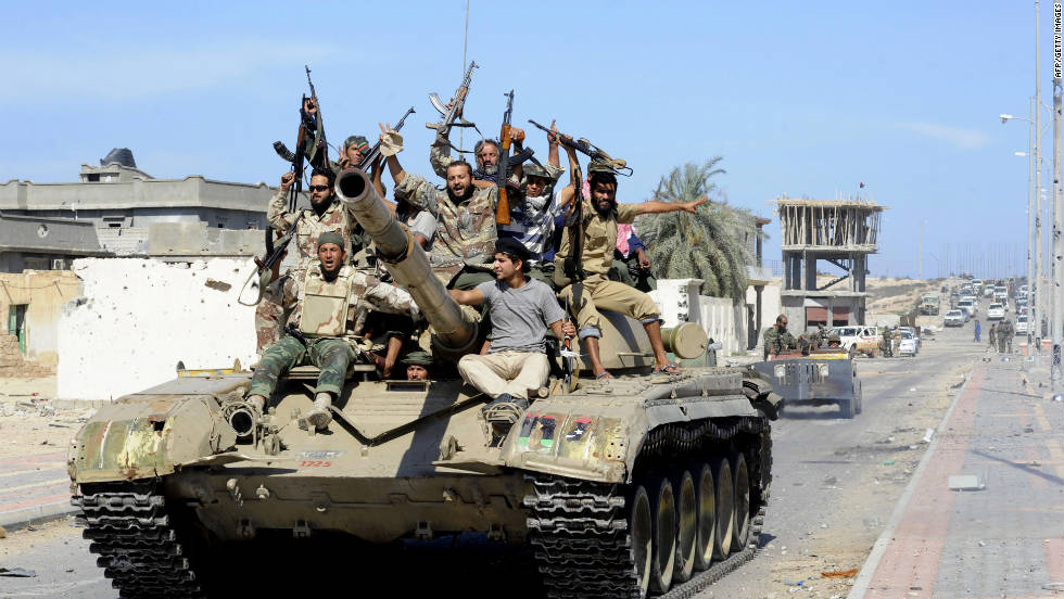 Libyan National Transitional Council fighters celebrate atop a tank in the coastal city of Sirte on Thursday.