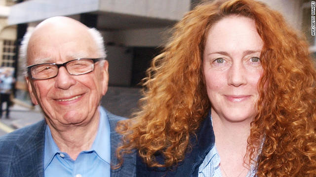 Rebekah Brooks, seen here with Rupert Murdoch, has been arrested but not charged over the police bribery probe.