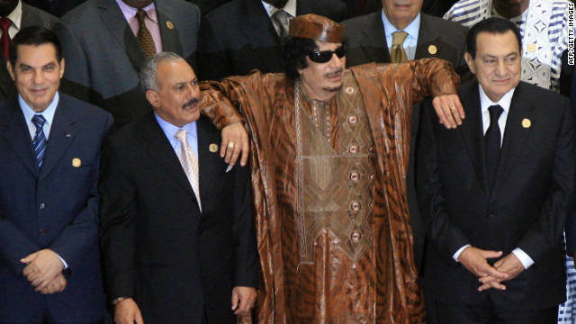 Libyan leader Moammar Gadhafi leans on Egyptian President Hosni Mubarak and Yemeni President Ali Abdullah Saleh in the 2nd Afro-Arab Joint Summit in Sirte, on October 10, 2010.
