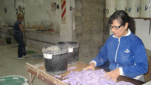 "Carmen Perez, a balloon factory supervisor in Buenos Aires, says: ""Before, we couldn't buy anything. And now we can. """