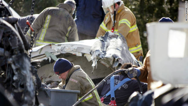 Investigators and rescue workers sift through the debris of Continental Connection Flight 3407 in 2009.