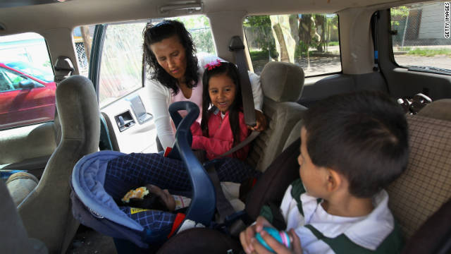 Jeanette Vizguerra and her children leave a May 23 meeting at the Mexican consulate about her deportation in Denver, Colorado.