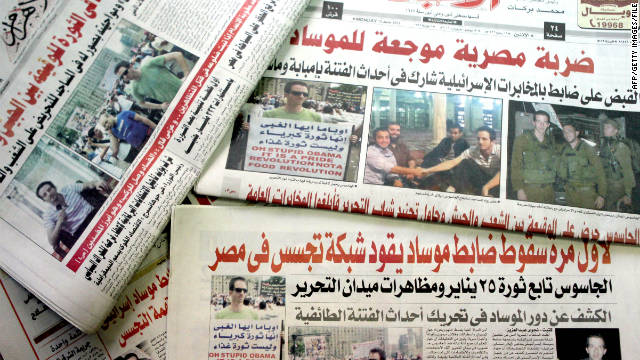 Ilan Grapel, a U.S.-Israeli citizen arrested June 12 on suspicion of spying, is pictured on Egyptian newspapers dated June 13.