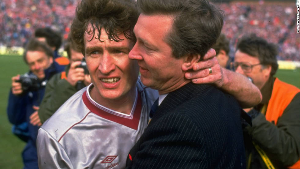 Ferguson hugs Sandy Jardine (left) of Hearts after guiding Aberdeen to a fourth Scottish Cup win in 1986. It was his last success with the Dons, having won three Scottish league titles and the 1983 European Cup Winners' Cup -- beating mighty Real Madrid in the final.