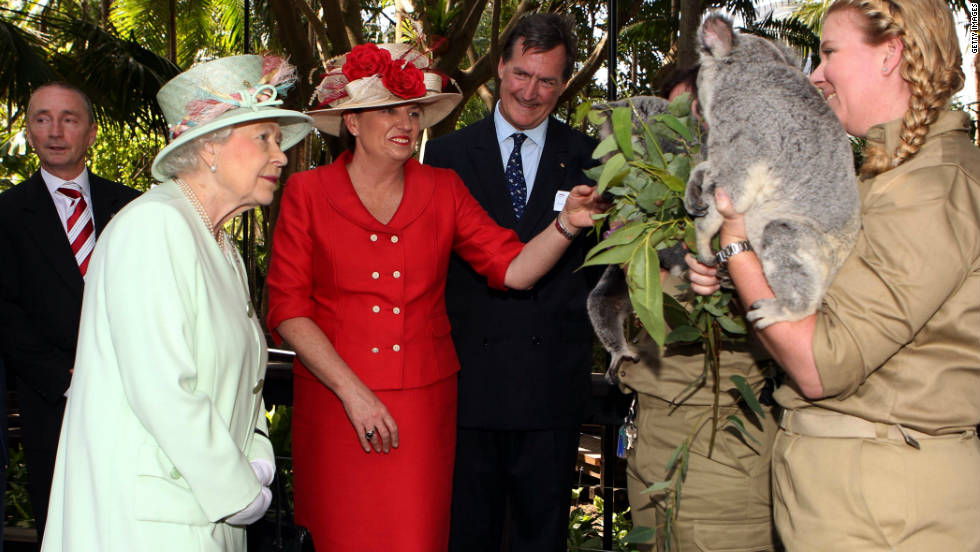 Queensland Premier Anna Bligh shows Queen Elizabeth II a koala during a visit to Rainforest Walk, Southbank, in October  2011, in Brisbane, Australia.