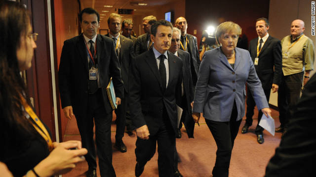 German Chancellor Angela Merkel (C) and French President Nicolas Sarkozy (L) walk in a corridor on their way to a joint press conference as part of the European Council on October 23.